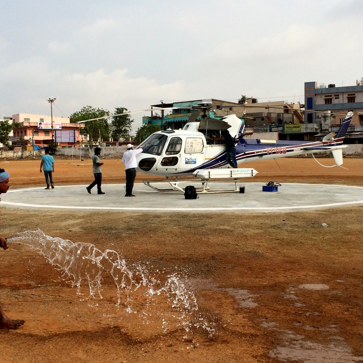 watering heli pad before take off
